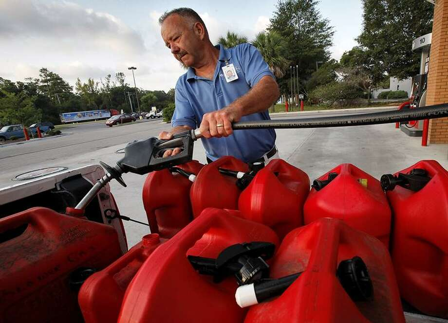 """I think the retailers will jack up prices overnight. We'll go through the gas anyway,"" said Plantation Resort landscaping manager Chris Jaeger as he filled his truck and 10 5-gallon gas containers Tuesday in Garden City, S.C. He said they gassed up their vehicles Monday and just want to be prepared in case Hurricane Irene hits the area.   Associated Press"