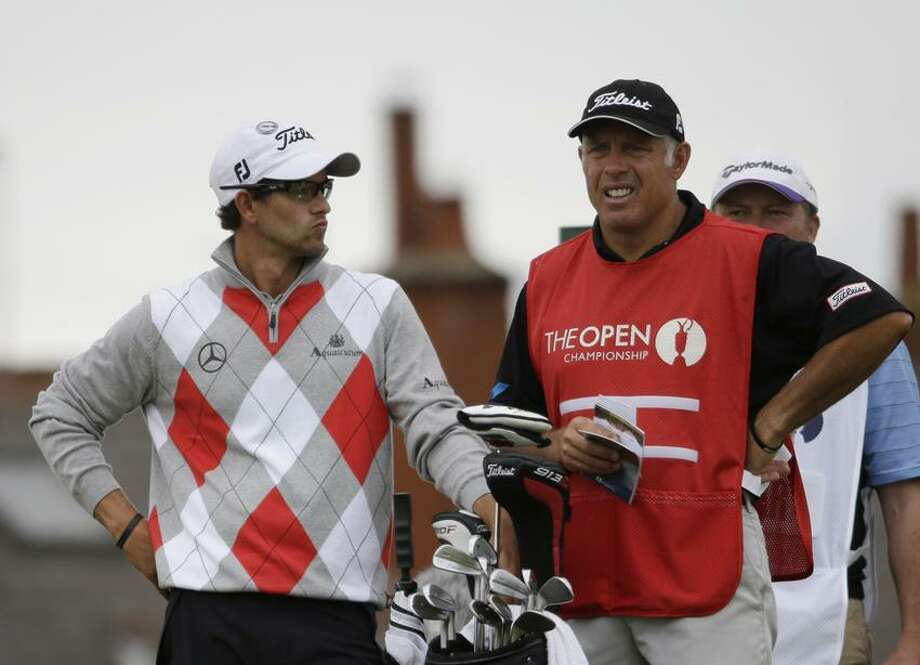 Adam Scott of Australia with his caddie Steve Williams talk on the eighth tee at Royal Lytham & St Annes golf club during the first round of the British Open Golf Championship, Lytham St Annes, England, Thursday, July 19, 2012. (AP Photo/Chris Carlson) Photo: AP / AP2012