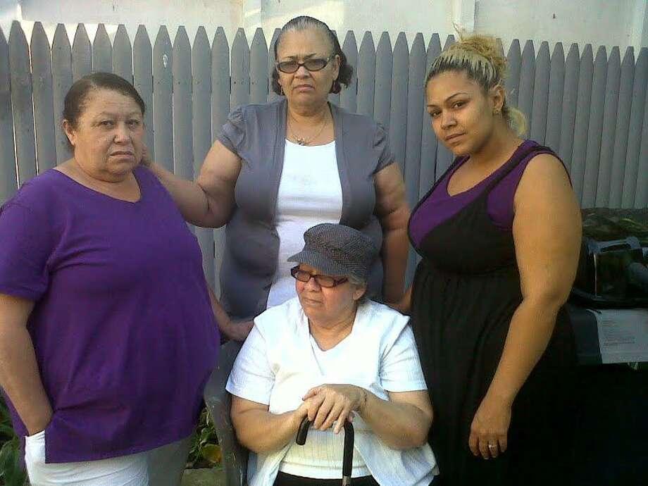 From left, standing, Santiago-Rivera's wife Virginia Candelario, sister Marisol Rosario, niece Sermarie Flores. Mother Elizabeth Rivera is seated. (William Kaempffer/Register)