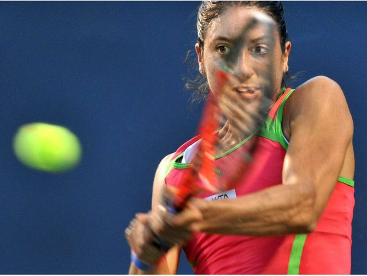 NEW HAVEN OPEN--American Christina McHale keeps her eye on the ball Monday in first round play at the New Haven Open at Yale. McHale defeated Svetlanta Kuznetsova in straight sets at the Connecticut Tennis Center. Melanie Stengel/Register