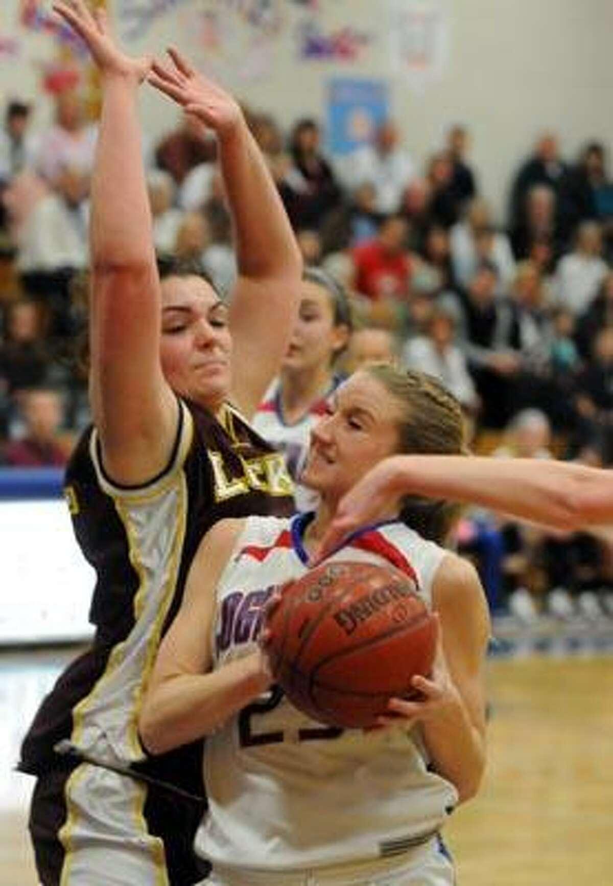 Class S girls basketball tournament, Windsor Locks at Coginchaug (Durham), second quarter. Windsor Locks' Nikki LaPierre left and Coginchaug's Amanda Boyle. Photo by Mara Lavitt/New Haven Register3/3/11