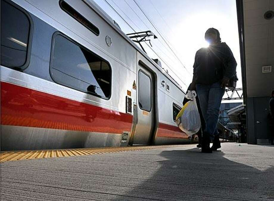 A passenger leaves one of the M8 Metro-North cars after it returned from Grand Central Station to Stamford. The new cars made their first round trip today and will start being used from New Haven to Grand Central later in the week. (Peter Casolino/New Haven Register)
