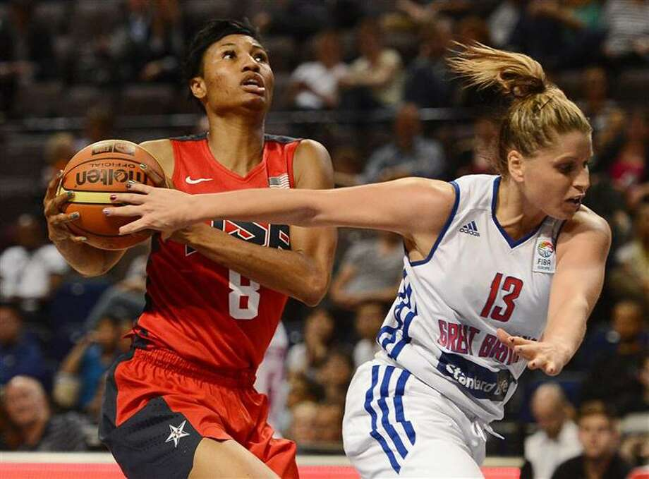 Johannah Leedham, right, of Team Great Britain challenges Team USA's Angel McCoughtry during an exhibition game on Wednesday. (REUTERS/Nigel Roddis) Photo: REUTERS / X02020