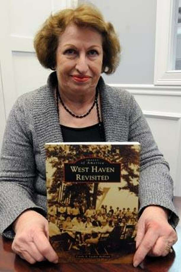 """Carole Laydon McElrath with the """"West Haven Revisited"""" book she wrote. (Mara Lavitt/New Haven Register)"""