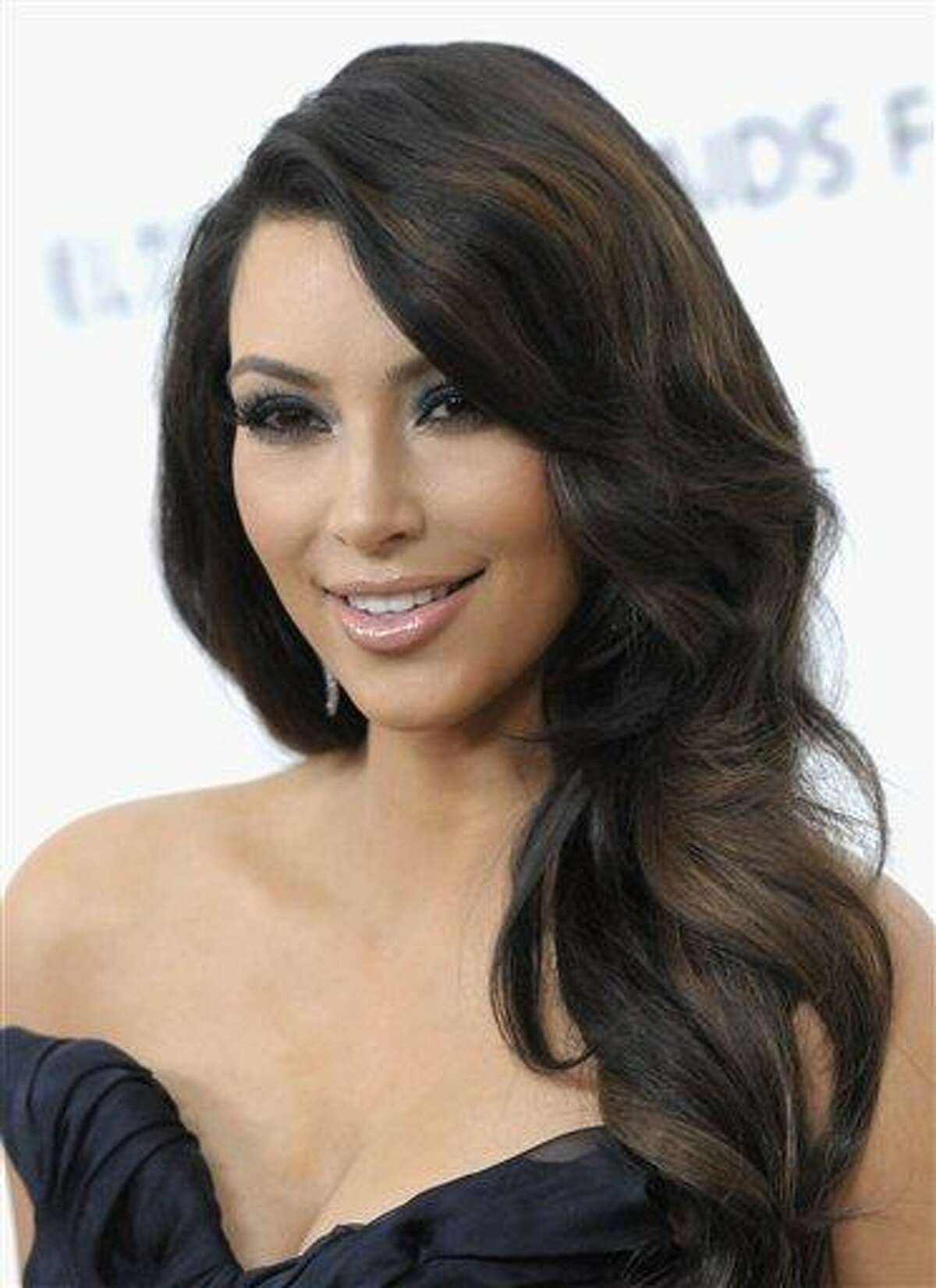 Television personality Kim Kardashian arrives at the 2011 Elton John Academy Award viewing party in West Hollywood, Calif. on Sunday, Feb. 27, 2011. (AP Photo/Dan Steinberg)