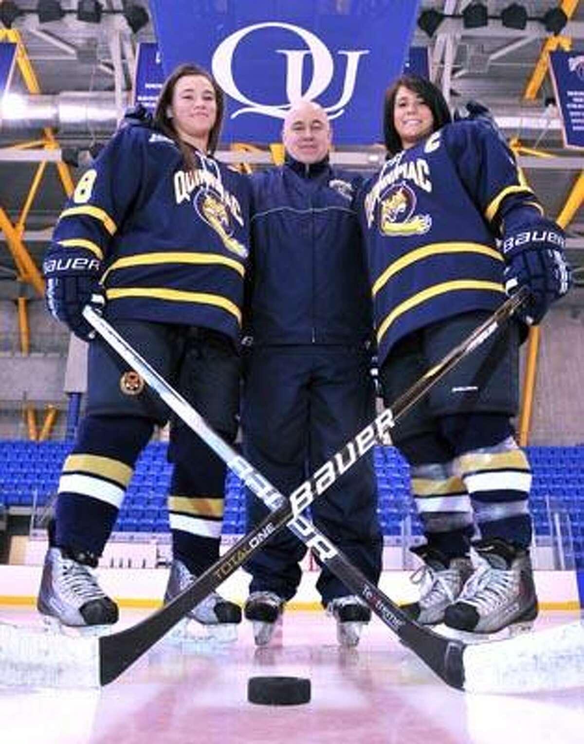 Hamden--Quinnipiac University women's hockey's Kelly Babstock, Coach Rick Seeley and Captain Jordan Elkins. Photo by Brad Horrigan/New Haven Register-03.02.11.