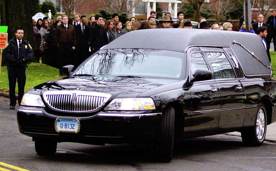 Fairfield--The hearse leaves the Abraham L. Green & Son Funeral Home in Fairfield after services for Noah Pozner, 6, victim of the Sandy Hook Elementary School massacre. Photo-Peter Casolino 12/17/12,