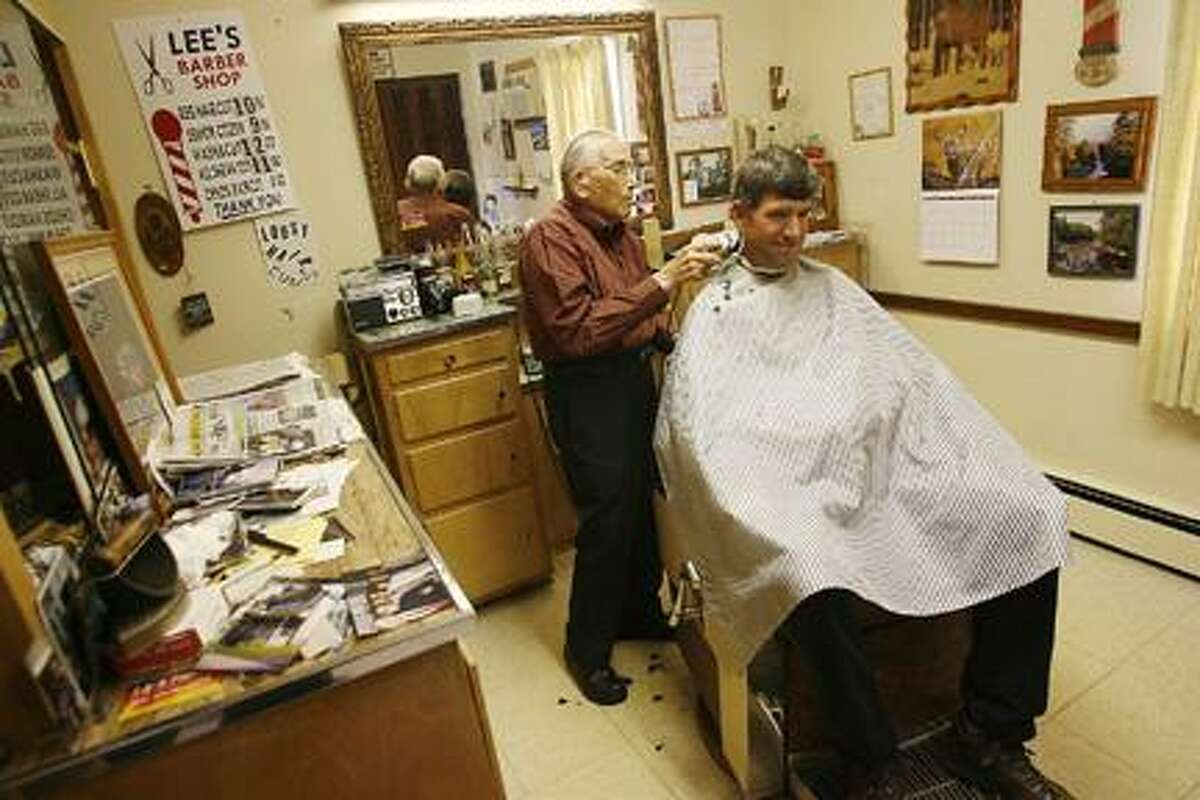 Dispatch Staff Photo by JOHN HAEGER (Twitter.com/OneidaPhoto)Lee LaGoy cuts the Ron Smith's hair at his Vernon barber shop on Friday, Aug. 19, 2011. Smith is a Verona resident.