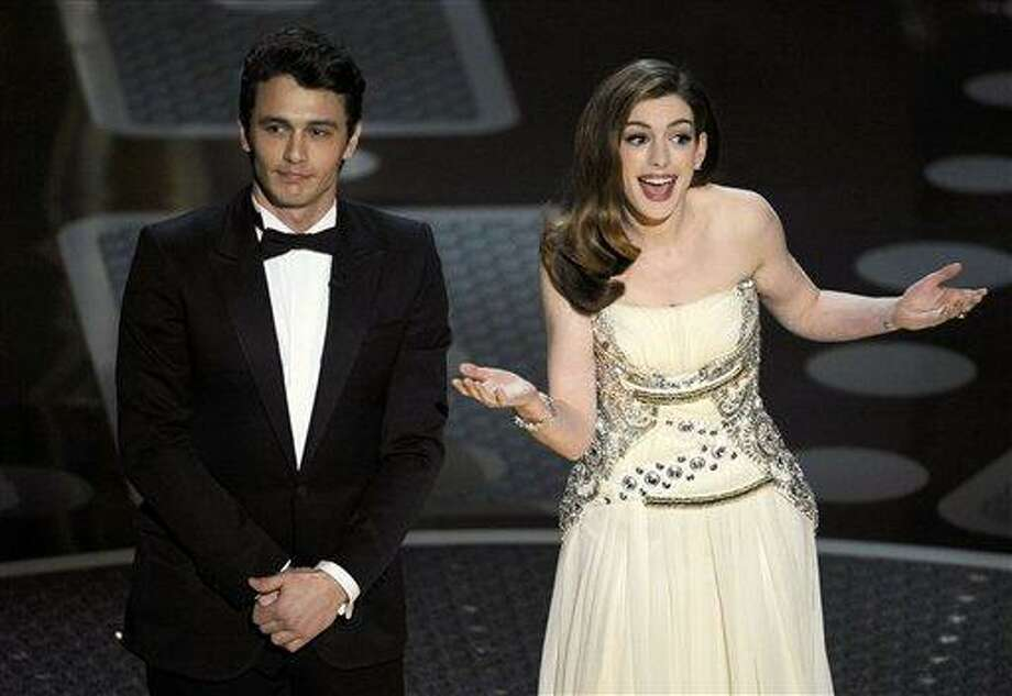Hosts James Franco, left, and Anne Hathaway are seen onstage during the 83rd Academy Awards on Sunday, Feb. 27, 2011, in the Hollywood section of Los Angeles. (AP Photo/Mark J. Terrill) Photo: ASSOCIATED PRESS / AP2011
