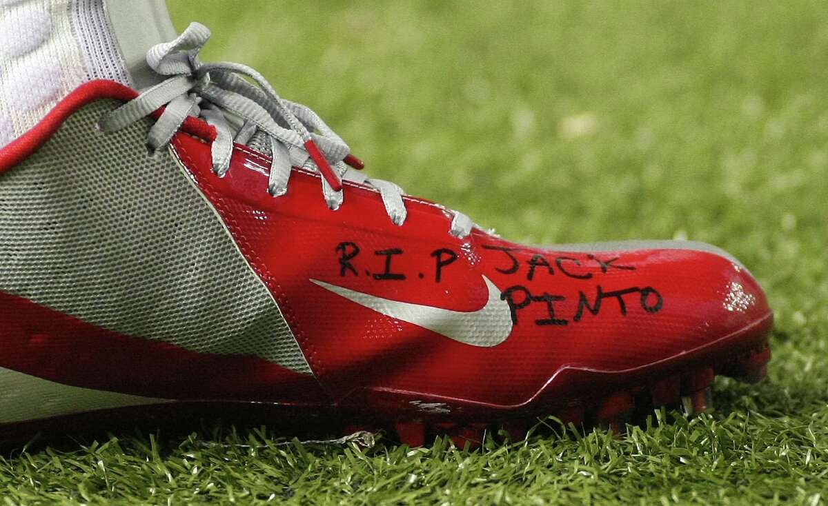 New York Giants wide receiver Victor Cruz wrote messages of support to Newtown shooting victim Jack Pinto on his cleats prior to the Giants' game against the Atlanta Falcons Sunday. Pinto, a 6-year-old aspiring athlete, was on a Newtown youth wrestling team and idolized Cruz. (Photo by Tami Chappell/Rueters)