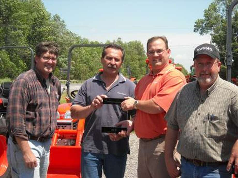 Submitted PhotoPictured from left are Jeffrey White, sales manager; Doug White, owner of WhiteÕs Farm SupplyÕ Jeremy Cook, Kubota representative for WhiteÕs Farm Supply and John Murray, salesman for WhiteÕs Farm Supply.