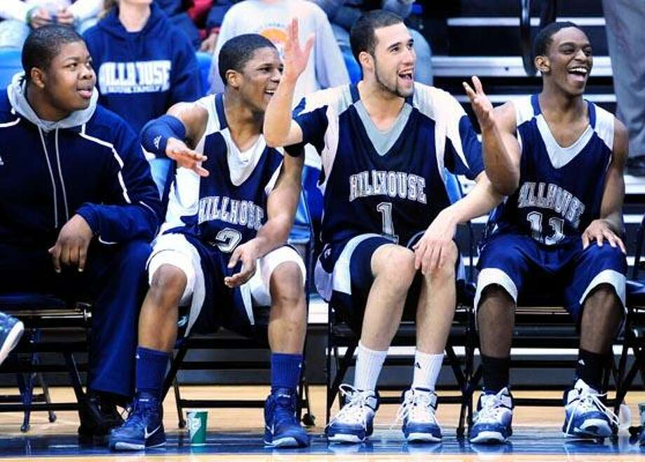 Andre Anderson (center left), Fred Wilson, Jr., (center right) and Lemuel Crudup (right) of Hillhouse celebrate in the final minute of their game against Career in the SCC Boys Basketball Championship Game at the TD Bank Sports Center in Hamden on 3/2/2011.Photo by Arnold Gold/New Haven Register     AG0404C