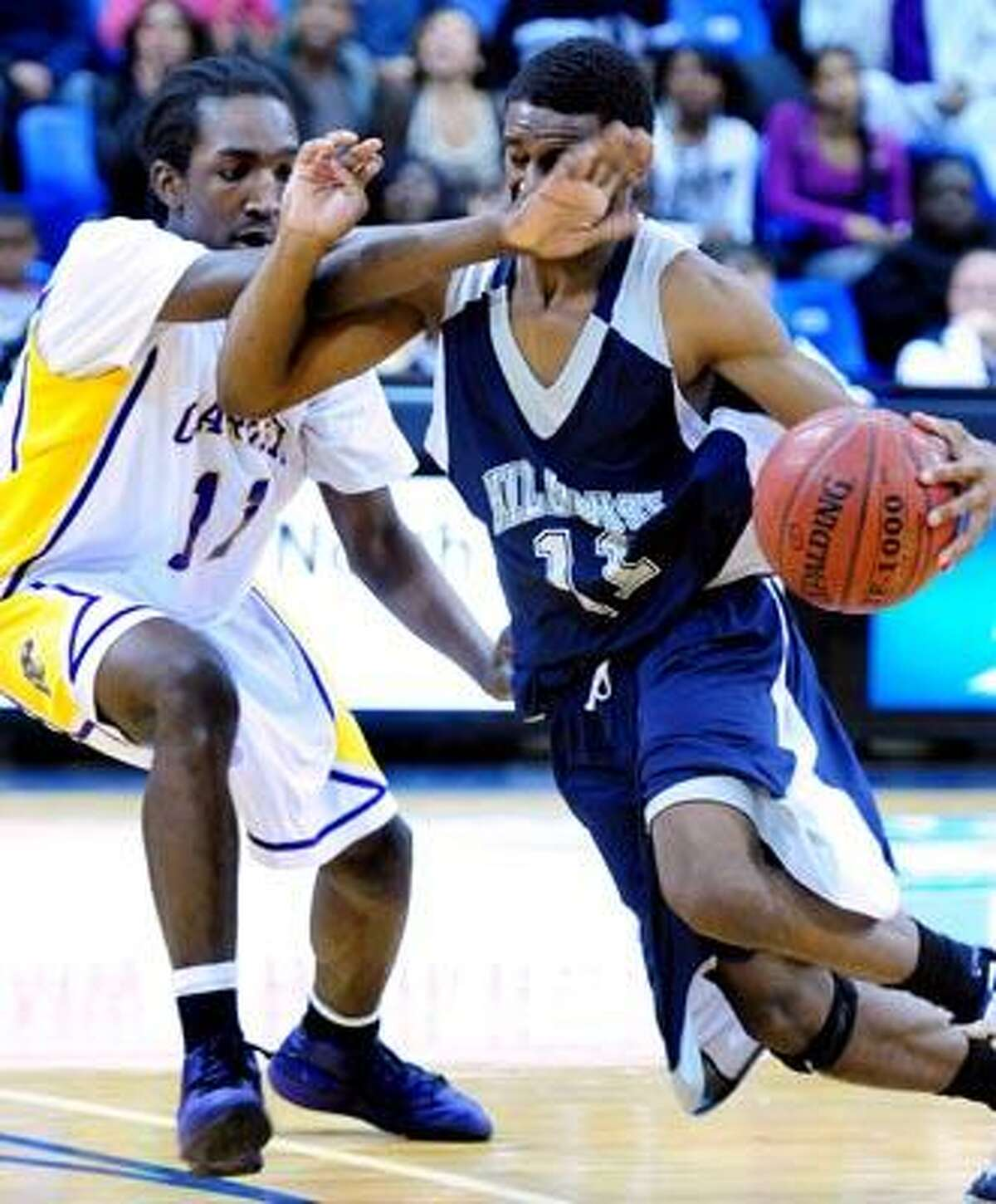 Treyvon Moore (left) of Career tries to guard Lemuel Crudup (right) of Hillhouse in the SCC Boys Basketball Championship Game at the TD Bank Sports Center in Hamden on 3/2/2011.Photo by Arnold Gold/New Haven Register AG0404C