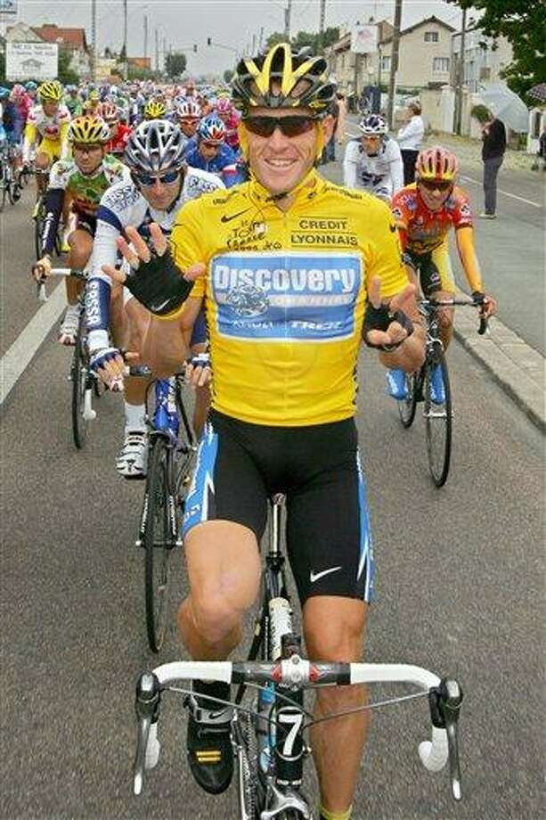 FILE - In this July 24, 2005, file photo, overall leader Lance Armstrong, of Austin, Texas, signals seven for his seventh straight win in the Tour de France cycling race, as he pedals during the 21st and final stage of the race between Corbeil-Essonnes, south of Paris, and the French capital. Federal prosecutors said, Friday, Feb. 3, 2012, they are closing a criminal investigation of Armstrong and will not charge him over allegations the seven-time Tour de France winner used performance-enhancing drugs. (AP Photo/Peter Dejong, File) Photo: AP / AP2005