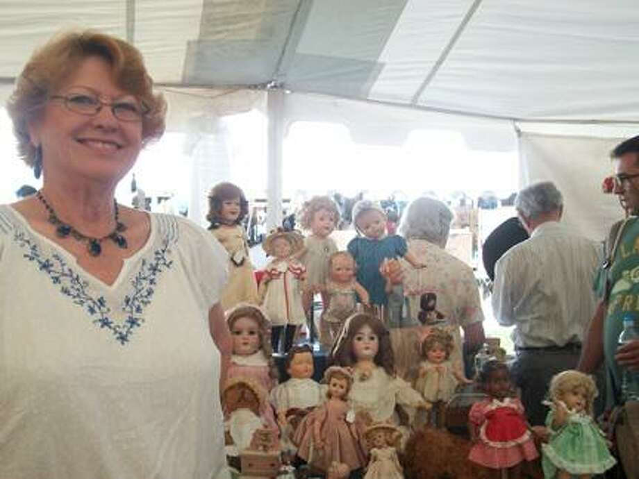 Photo by JEN ARMSTRONG Dolls for sale in Bouckville at the Madison-Bouckville Antique Festival Friday, Aug. 19, 2011.