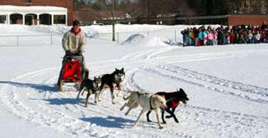 Photo Courtesy E. R. ANDREWS ELEMENTARY SCHOOL Dakota Browning races his sled dogs around E. R. Andrews Elementary School.