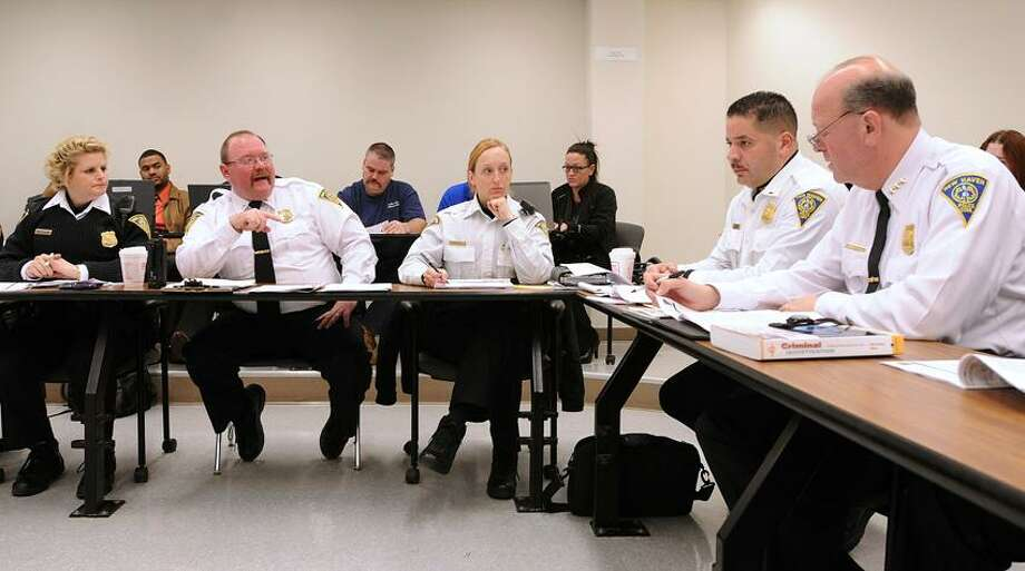 New Haven-- New Haven Police Chief Dean Esserman, right, conducts the weekly COMPSTAT meeting with his department. They are, right to left; Lt. Louiz Casanova, Lt. Rebecca Sweeney, Lt. Martin Tchakirides and Lt. Holly Wasilewski. Peter Casolino/New Haven Register01/31/12