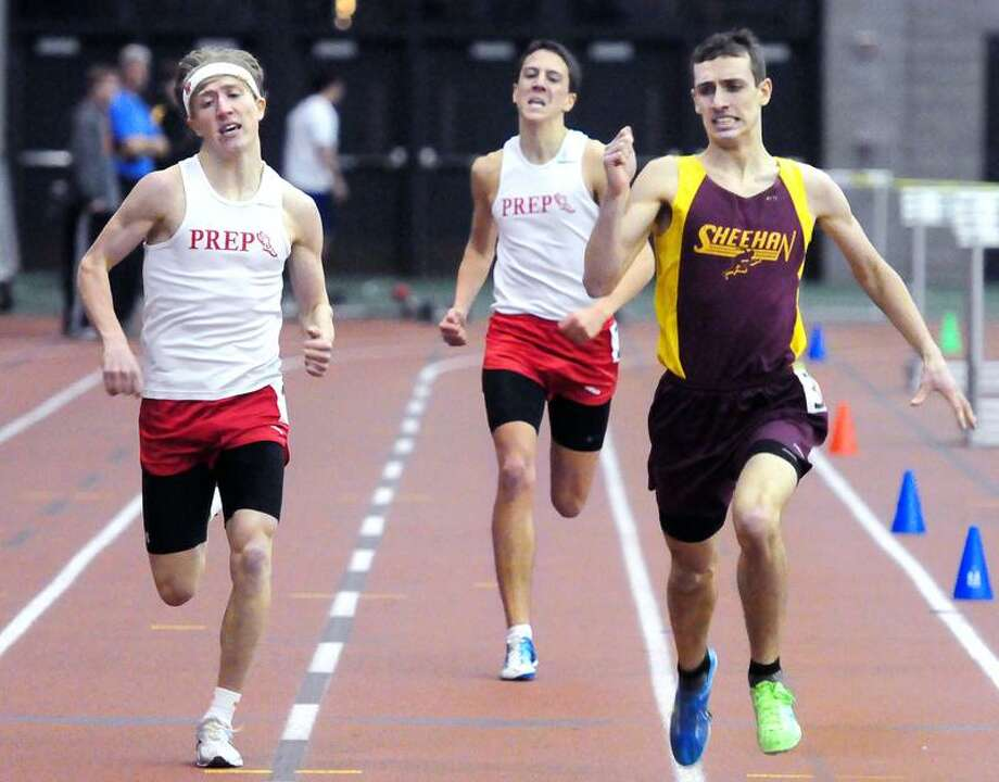 Tom Lupoli, right, of Sheehan finishes first in the 1000-meter run at the SCC indoor track championships at the Floyd Little Athletic Center. At left is Connor Rog of Fairfield Prep finishing second and in center is teammate Patrick Corona finishing third. Photo by Arnold Gold/New Haven Register