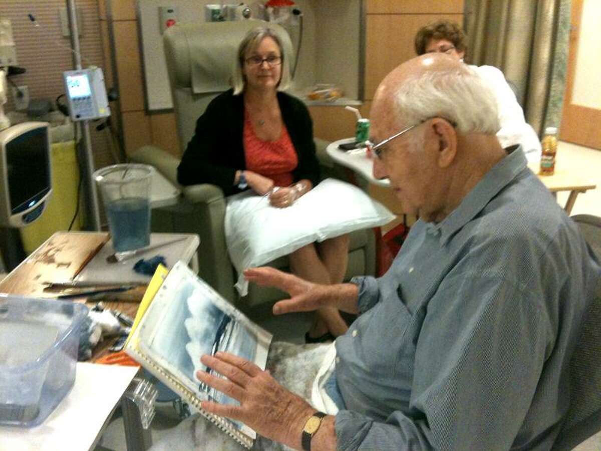Ann DeMatteo/Register Yale-New Haven Hospital volunteer Dennis Gentle, 87, paints for chemo patient Julia Jonathan of Guilford. He was honored at Yale-New Haven Hospital last week. Her friend Ellen Wormser is on the right.