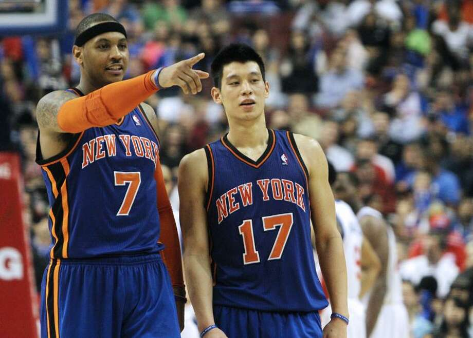 New York Knicks forward Carmelo Anthony (7) and guard Jeremy Lin (17) talk prior to a free throw against the Philadelphia 76ers during an NBA basketball game on Wednesday, March 21, 2012, in Philadelphia. The Knicks won 82-79. (AP Photo/The Wilmington News-Journal, Daniel Sato)  NO SALES Photo: AP / The News Journal-2012