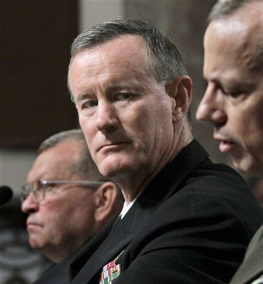 In this June 2011 file photo, Navy Vice Adm. William H. McRaven, center, is seen on Capitol Hill in Washington. As traditional military operations are cut back, the Pentagon is moving to expand the worldwide reach of the U.S. Special Operations Command to strike back wherever threats arise. U.S. officials say the Pentagon and the White House have embraced a proposal by special operations chief Adm. Bill McRaven to push troops that are withdrawing from war zones to reinforce special operations units in areas somewhat neglected during the decade-long focus on al-Qaida. At left is Gen. James D. Thurman, nominee to become commander of U.S. forces in Korea.  Associated Press Photo: AP / AP