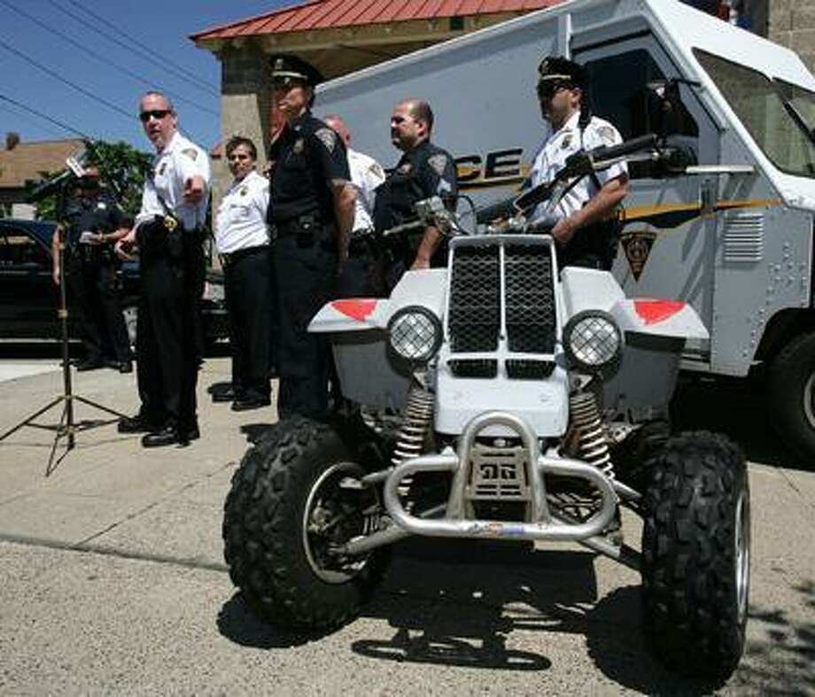 File photo: In 2010, New Haven Police LT. Jeff Hoffman, left,  talks about the police force's new initiative to curb unregistered motor vehicles from riding on the city streets. In the foreground is an ATV that was seized by the department. The focus of the plan is to stop ATV's and dirtbikes, but also includes a plan to curb quality of life issues like loud car music. The press conference was in front of the police substation at 295 Blatchley Ave. (Peter Casolino/Register)