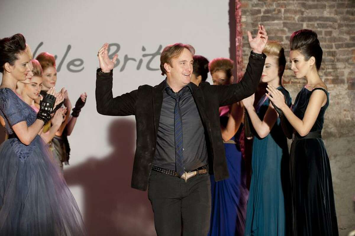 In this undated publicity image released by USA Network, Jay Mohr, center, is shown in character as fashion designer Nyle Brite during a guest appearance on the series,