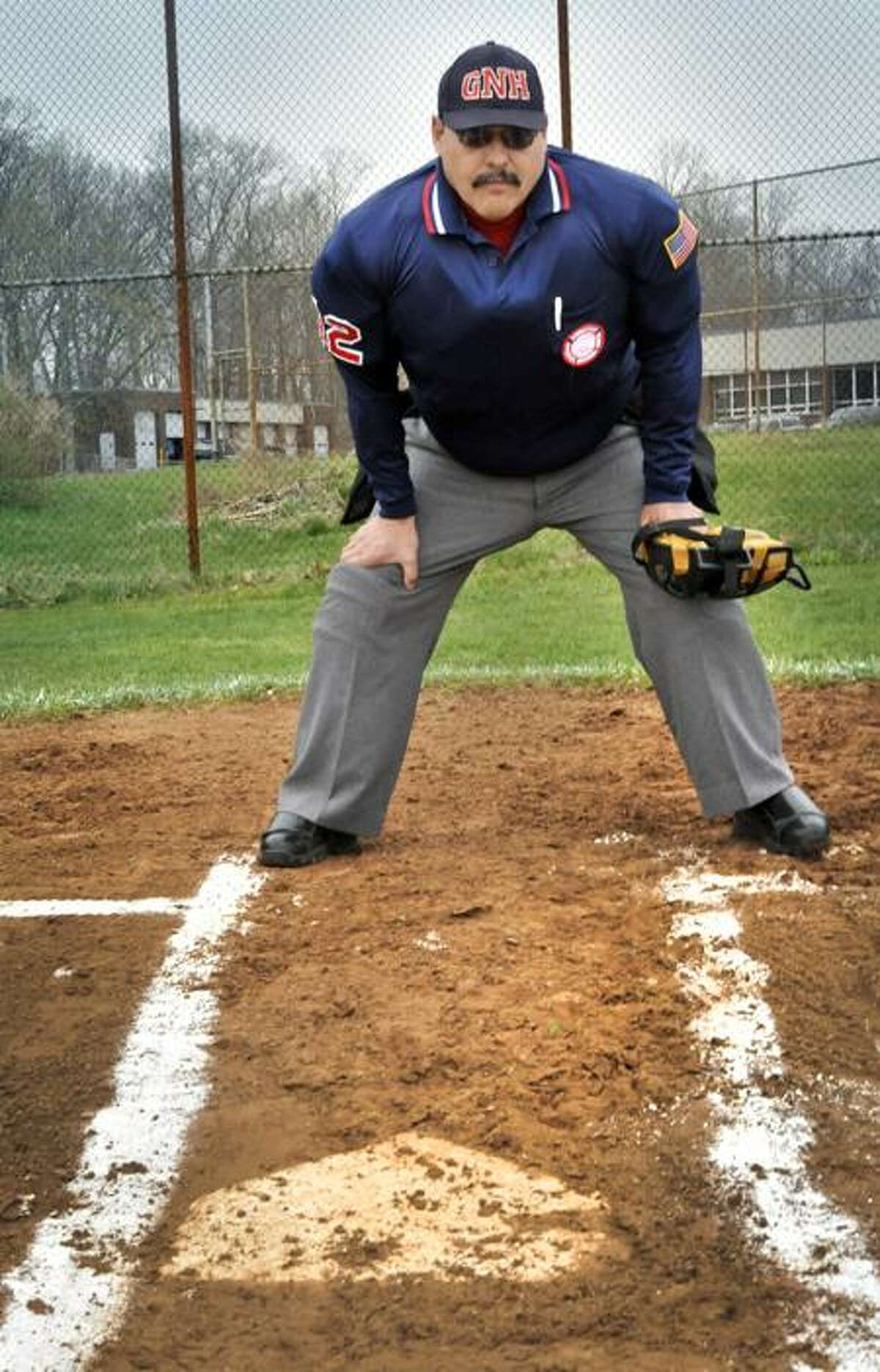 Fred Norman steps to the plate at the start of the Platt Tech game. Melanie Stengel/Register