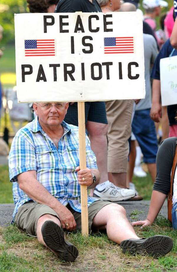 This year the I Wage Peace Walk was held in New Haven beginning on the New Haven Green and had planned on visiting a Christian, Jewish and Muslim places of worship. The walkers included James Linn of Milford. Mara Lavitt/New Haven Register