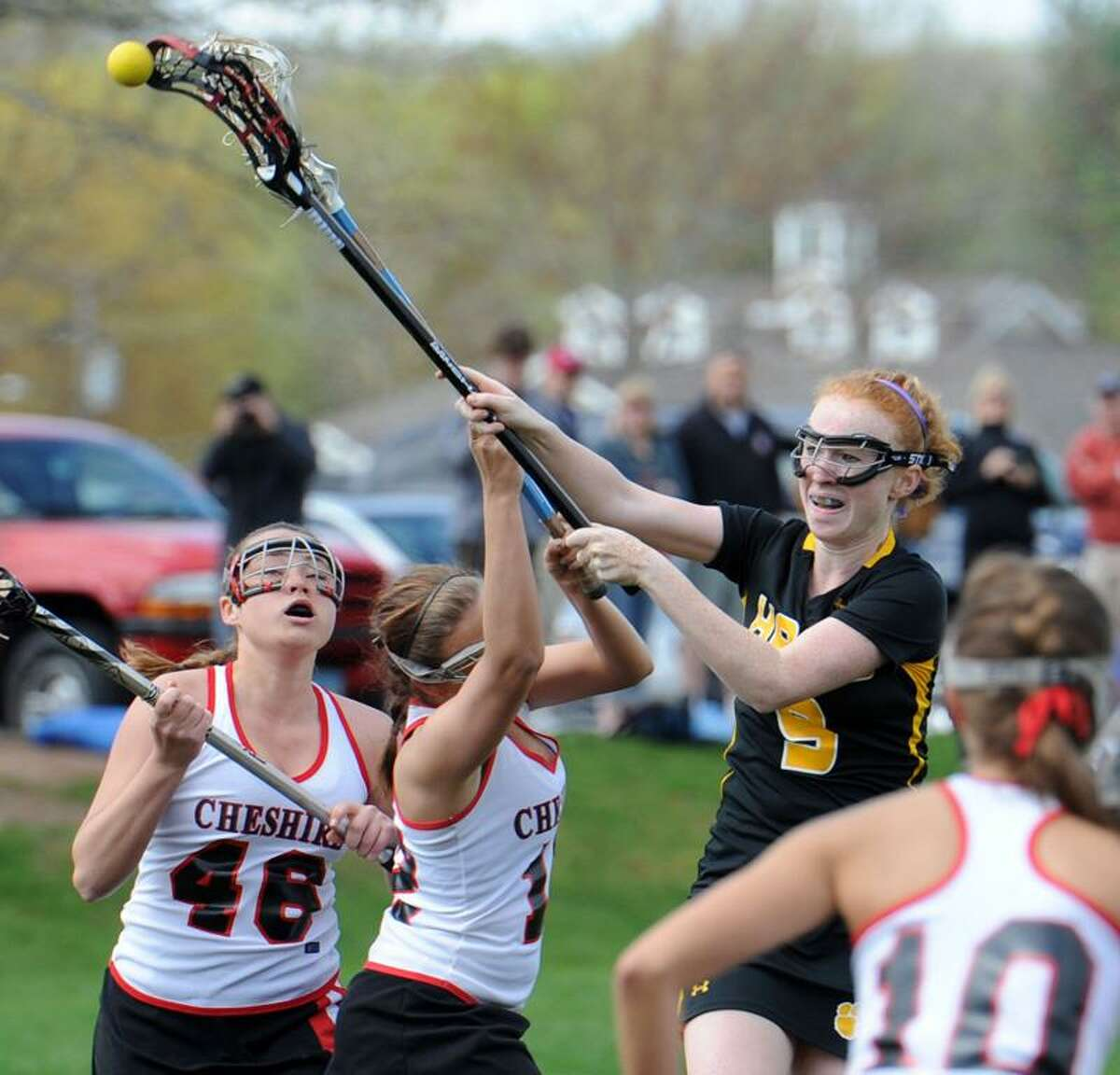 From left to right, Cheshire's Lauren Anderson, Paige Pikulski and Alyssa Hague right can't stop Hand's Hannah Morgan scoring Hand's 7th goal. Photo by Mara Lavitt/New Haven Register 4/30/11