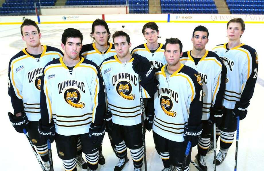 Quinnipiac University hockey defensemen (left to right) Mike Glaicar, Dan Federico, Mike Dalhuisen, Zack Curre, Zach Davies, Jack Callahan, Loren Barron and Zach Tolkinen are photographed at the TD Bank Sport Center at Quinnipiac University in Hamden on 1/31/2012.Photo by Arnold Gold/New Haven Register   AG0437C