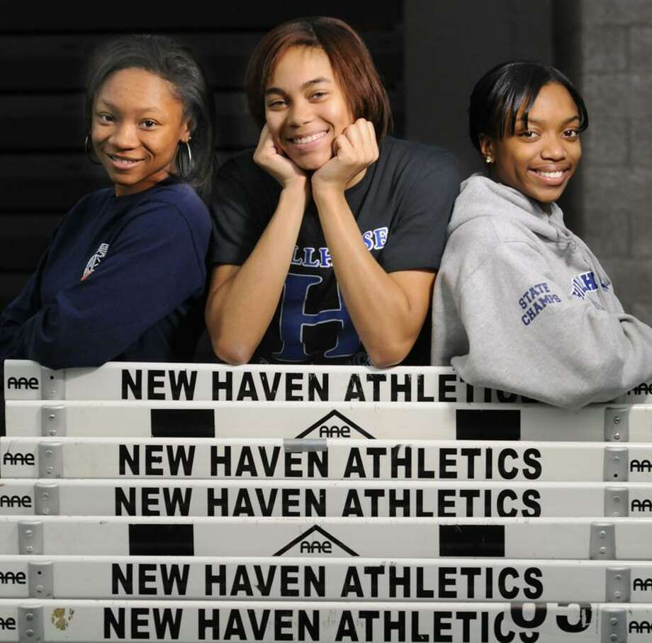 Hillhouse track stars Precious Holmes left,  Brianna Sims center, and Kellie Davis right at the Floyd Little Athletic Center in New Haven. Photo by Mara Lavitt/New Haven Register2/2/12