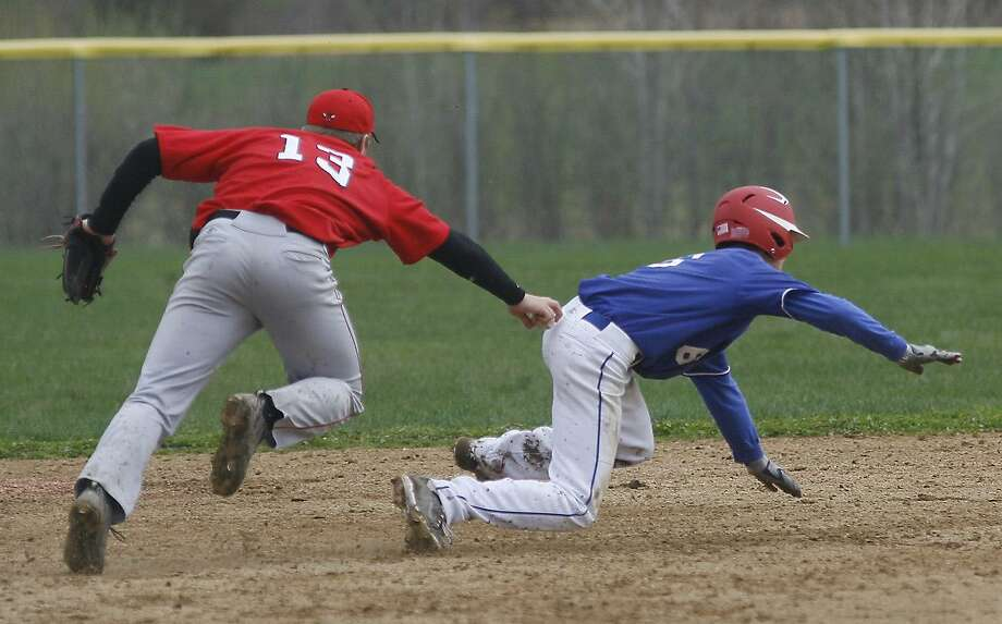 Dispatch Staff Photo by JOHN HAEGER VVS' Tyler Mautner (13) tags out New Hartford's Matt Deswns (6) to end the top of the fourth inning of play   in Friday's game at VVS. VVS won the April 29, 2011 game 10-5.