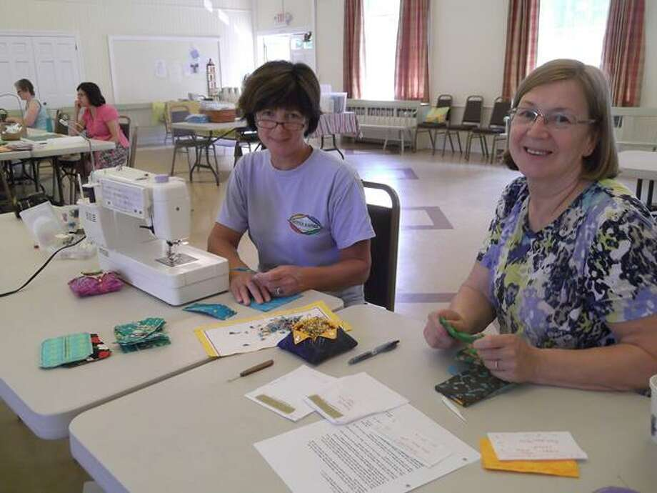 RICKY CAMPBELL/ Register Citizen  Volunteers sewed Smart Sacs together Saturday at St. Michael's in Litchfield. The reusable bags will be sold with the proceeds going to benefit the Greenwoods Counseling Referrals.