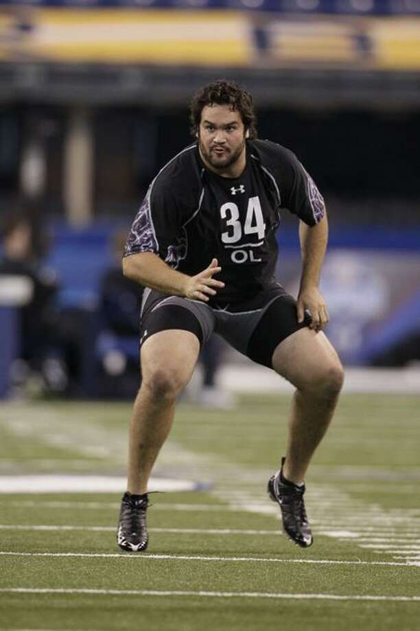 Wisconsin offensive lineman John Moffittruns a drill during the NFL football scouting combine in Indianapolis, Saturday, Feb. 26, 2011. (AP Photo/Darron Cummings) Photo: AP / AP2011