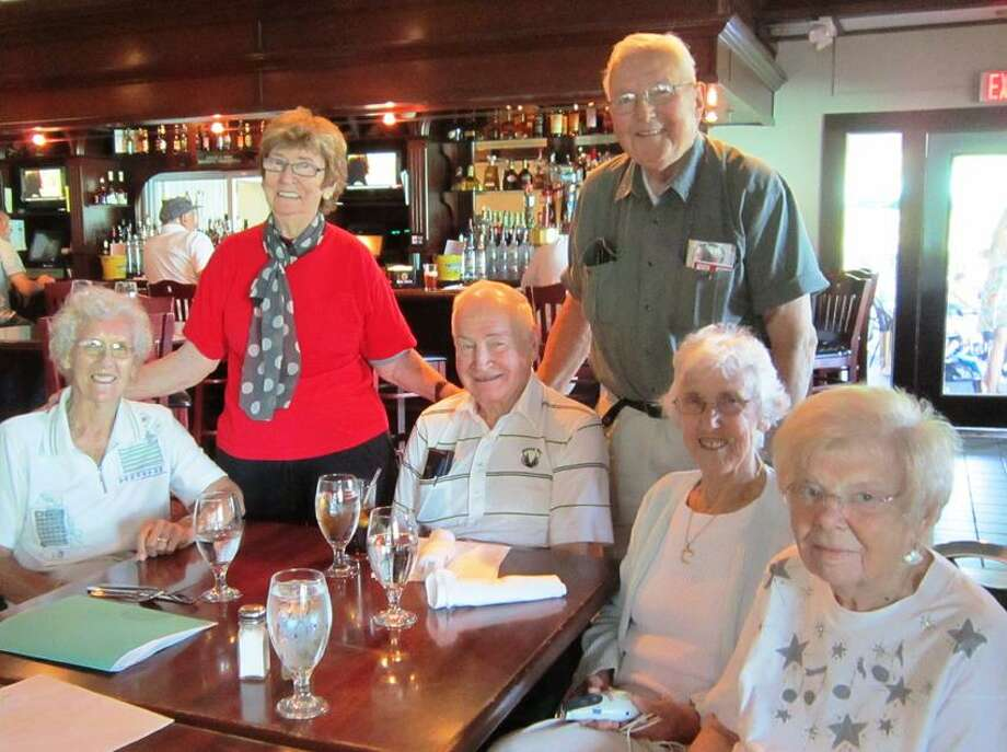Milford High School's class of 1944 gets ready for its 68th reunion: from left, Patricia Maiden Olenski, reunion Chairwoman Jackie Whitehead Musante, class of 1944 Vice President Trevor Davis, Ed J. Kozlowski Sr., Claire Coulombe Phelan and Valarie Hitt George. Dotty Kozlowski/For the Register