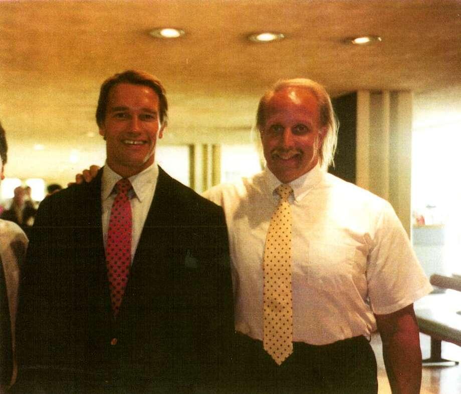 Hamden's Mike Katz, right, with Arnold Schwarzenegger. (Register file photo)