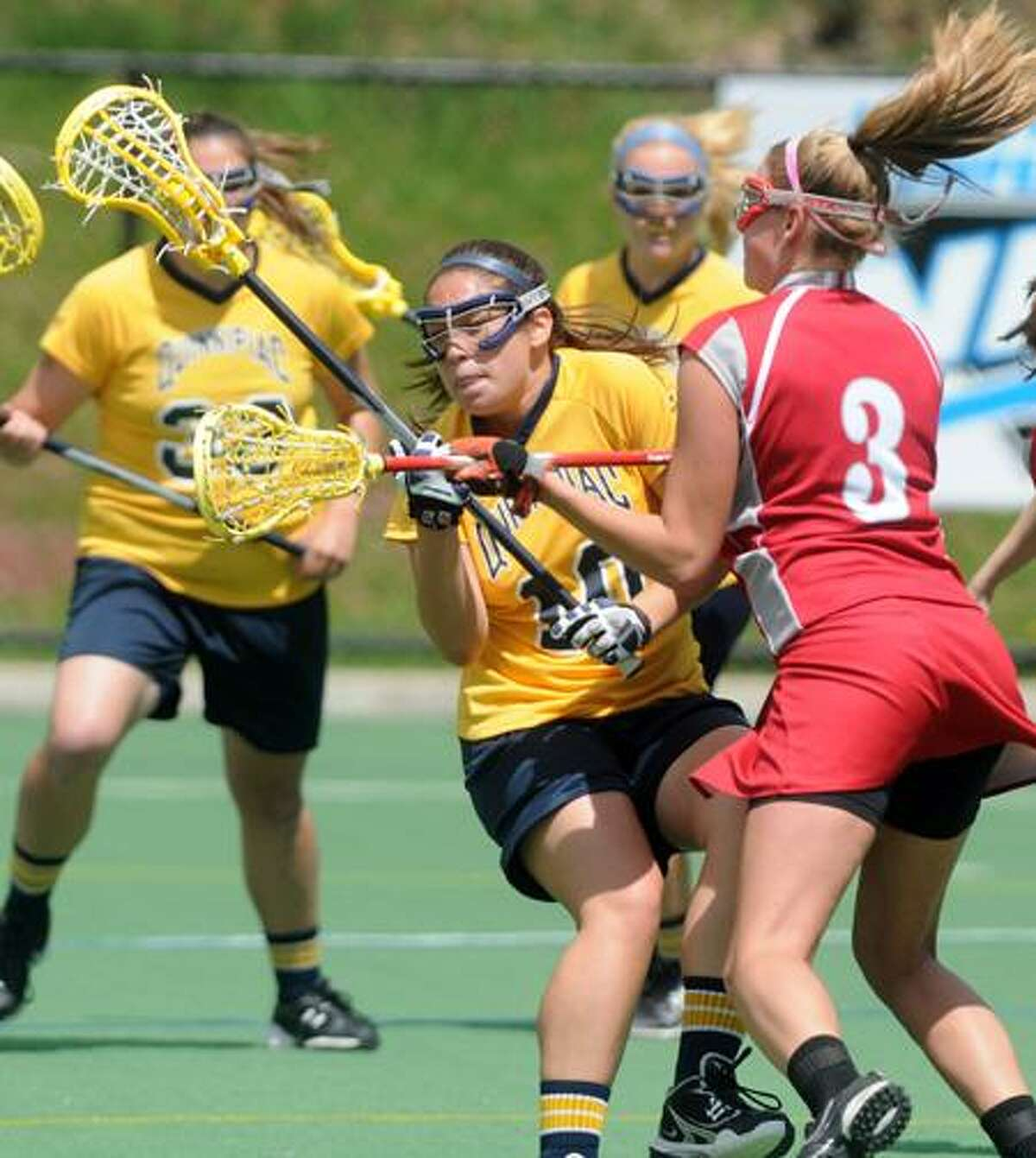 Sacred Heart against Quinnipiac Univ. in the NEC women's lacrosse semi-final at QU, first half action. QU's Marissa Caroleo (#10) with the ball pressured by SHU's Kate Kmiotek (#3).Photo by Mara Lavitt/New Haven Register4/29/11