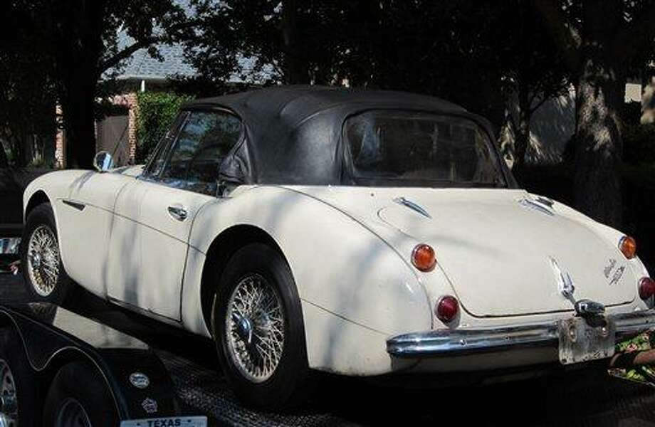 In this image provided by the Los Angeles County Sheriff's Department, the stolen car sits on a small transport trailer as it is delivered to Robert Russell's home in Texas. Russell whose prized 1967 Austin Healy sports car was stolen 42 years ago, recovered the vehicle after spotting it on eBay, authorities said Sunday July 15, 2012. Associated Press Photo: AP / Los Angeles County Sheriff's Department