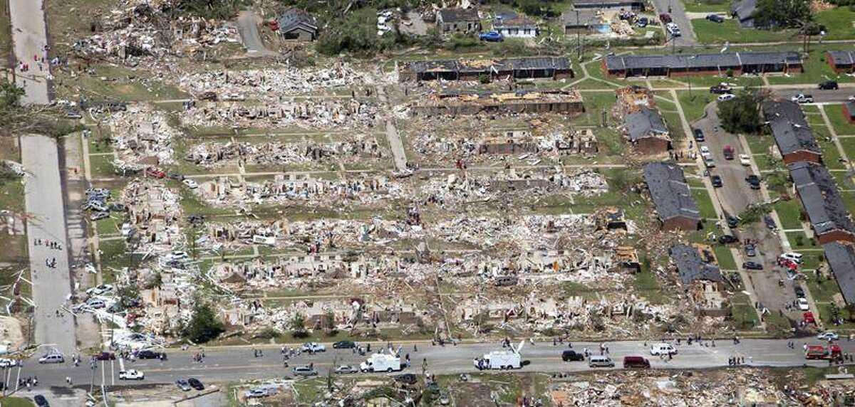 This aerial photo shows the devastation of The Rosedale Court housing community in Tuscaloosa, Ala. Thursday, after a tornado cut through Alabama Wednesday evening.