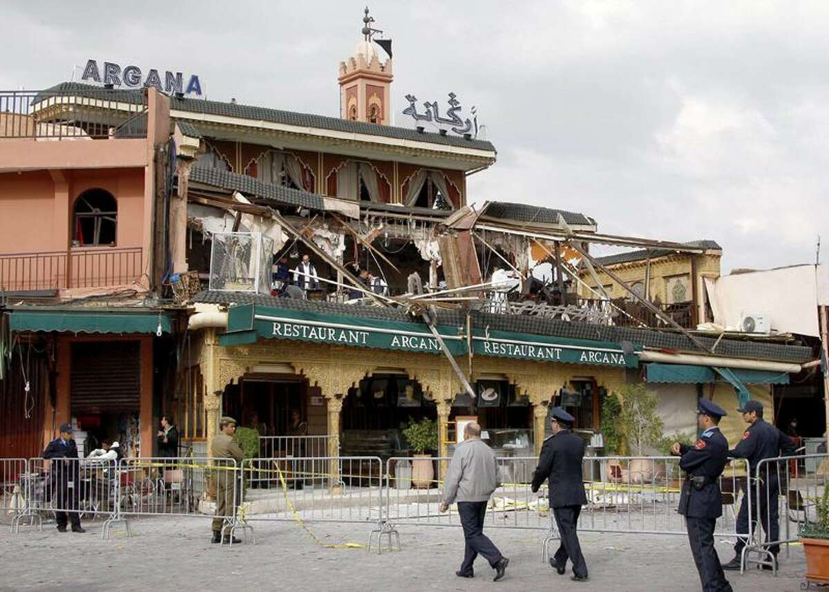 Police officers secure the scene at the Argana cafe in Djemma el-Fna square, Marrakech, Morocco, Thursday, after a terrorist bomb ripped through the cafe popular among tourists. Associated Press