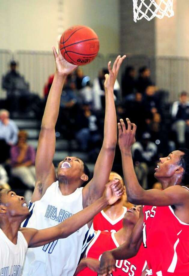 Hillhouse's Chaise Daniels tries to pull in a rebound against Wilbur Cross in the first half of Hillhouse's 60-39 win. Photo by Arnold Gold/New Haven Register