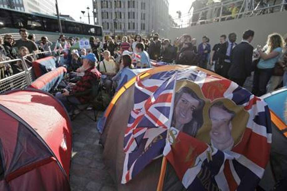 AP Photo/Lefteris Pitarakis Royal enthusiasts camp across the road from the Westminster Abbey in order to ensure the best viewing spot,  for the upcoming royal wedding, in central London, Wednesday, April 27, 2011. Britain's Prince William and Kate Middleton will get married at the Abbey on Friday, April 29, 2011. Photo: ASSOCIATED PRESS / AP2011