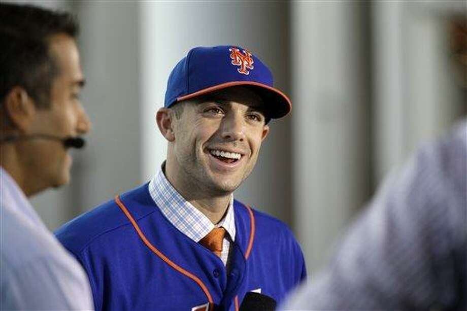 New York Mets third baseman David Wright answers questions during an interview at the baseball winter meetings on Wednesday, Dec. 5, 2012, in Nashville, Tenn. Wright has signed a contract extension with the Mets through 2020. (AP Photo/Mark Humphrey) Photo: ASSOCIATED PRESS / AP2012