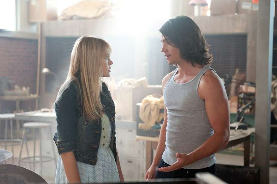 "Richard Foreman/Disney Pictures photo: Aimee Teegarden and Thomas McDonell in a scene from ""Prom."" Photo: AP / ©Disney Enterprises, Inc.  All Rights Reserved."