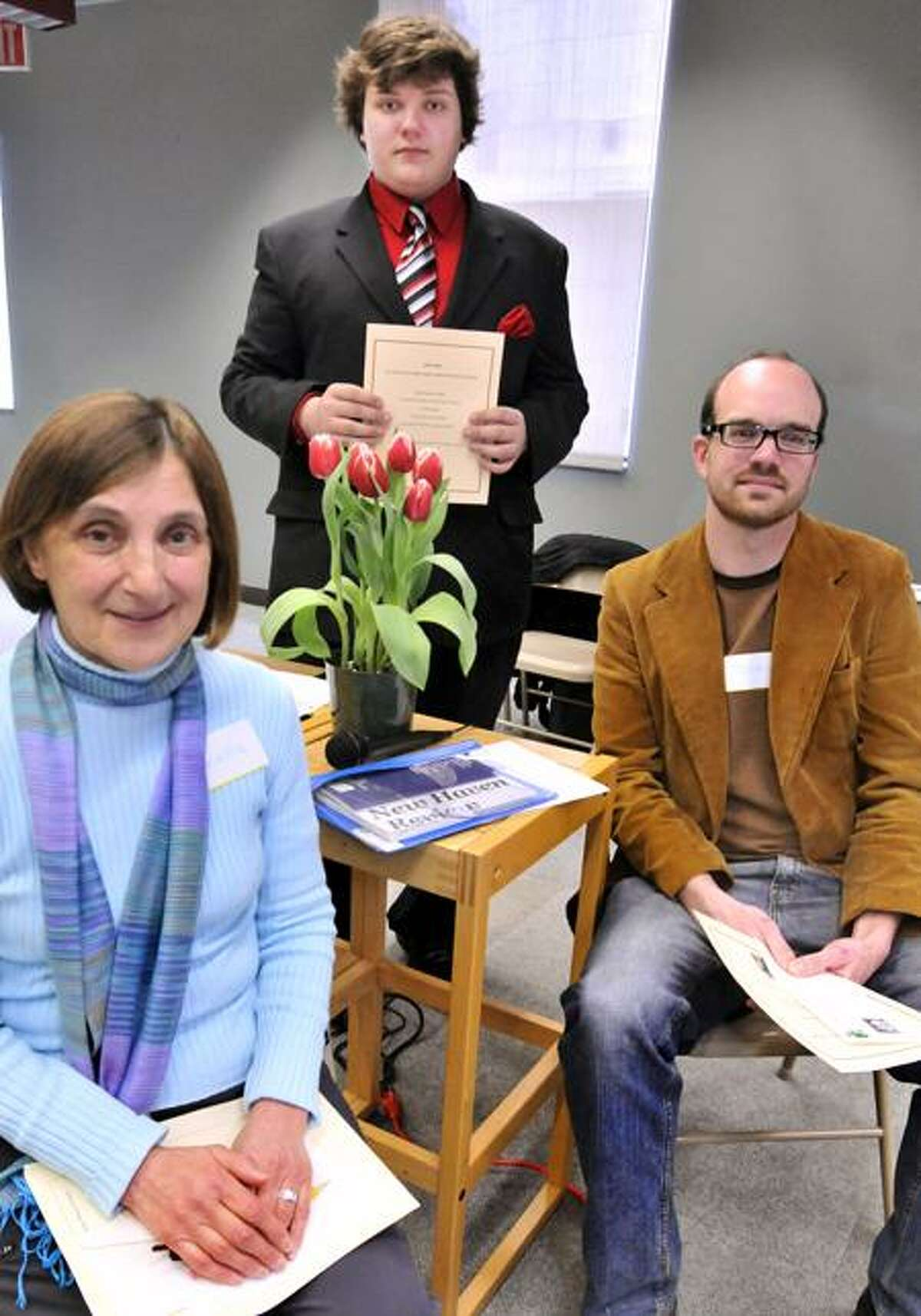 NEW HAVEN-Left to Right: Gabriella Brand, John Cubeta Zibluk, and Dennis Wilson, winners of the New Haven Library's poetry contest. Melanie Stengel/Register