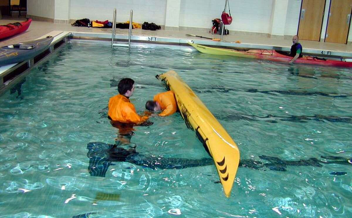 Martin Torresquintero photo: An instructor is close at hand when paddlers learn how to do an eskimo roll at one of the city's kayak clinics at Hillhouse High.