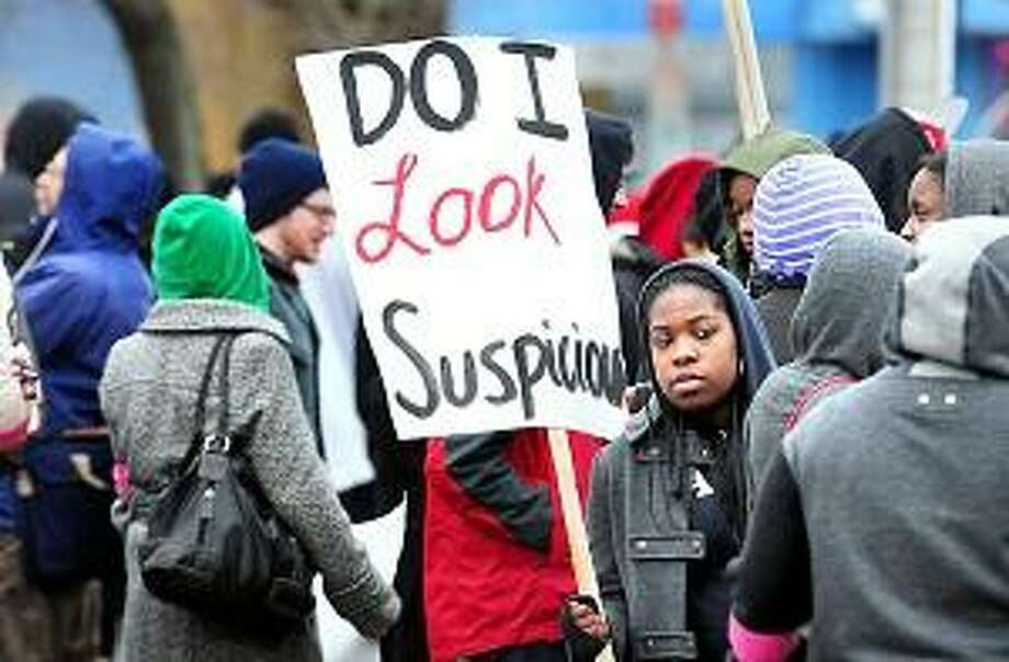 Yale University sophomore Edirin Okoloko (center) waits for the Hoodies Up New Haven march to begin on Dixwell Ave. New Haven on 3/31/2012.Photo by Arnold Gold/New Haven Register