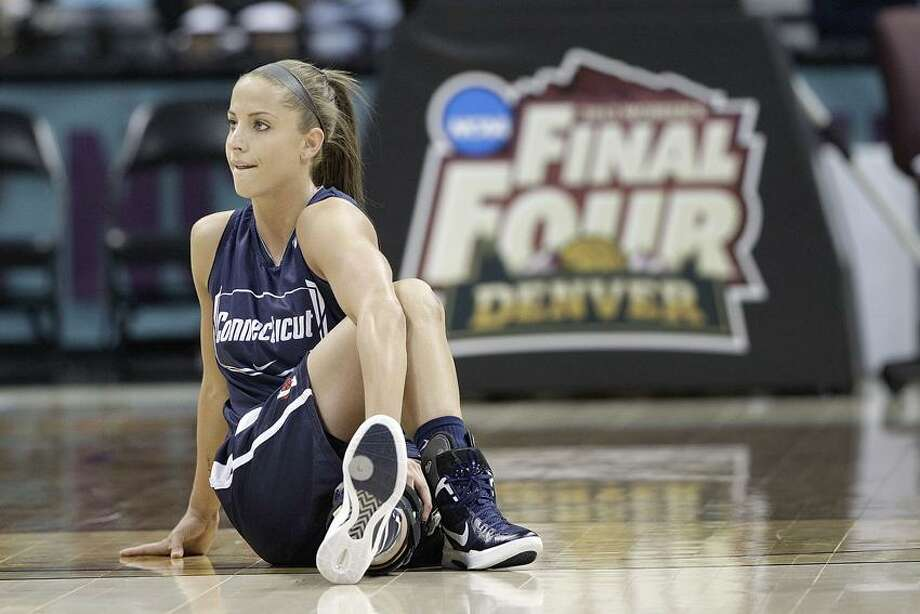 Connecticut guard Caroline Doty stretches during practice at the NCAA Women's Final Four college basketball tournament in Denver, Saturday, March 31, 2012. Connecticut takes on Notre Dame in a national semifinal on Sunday.(AP Photo/Eric Gay) Photo: AP / AP