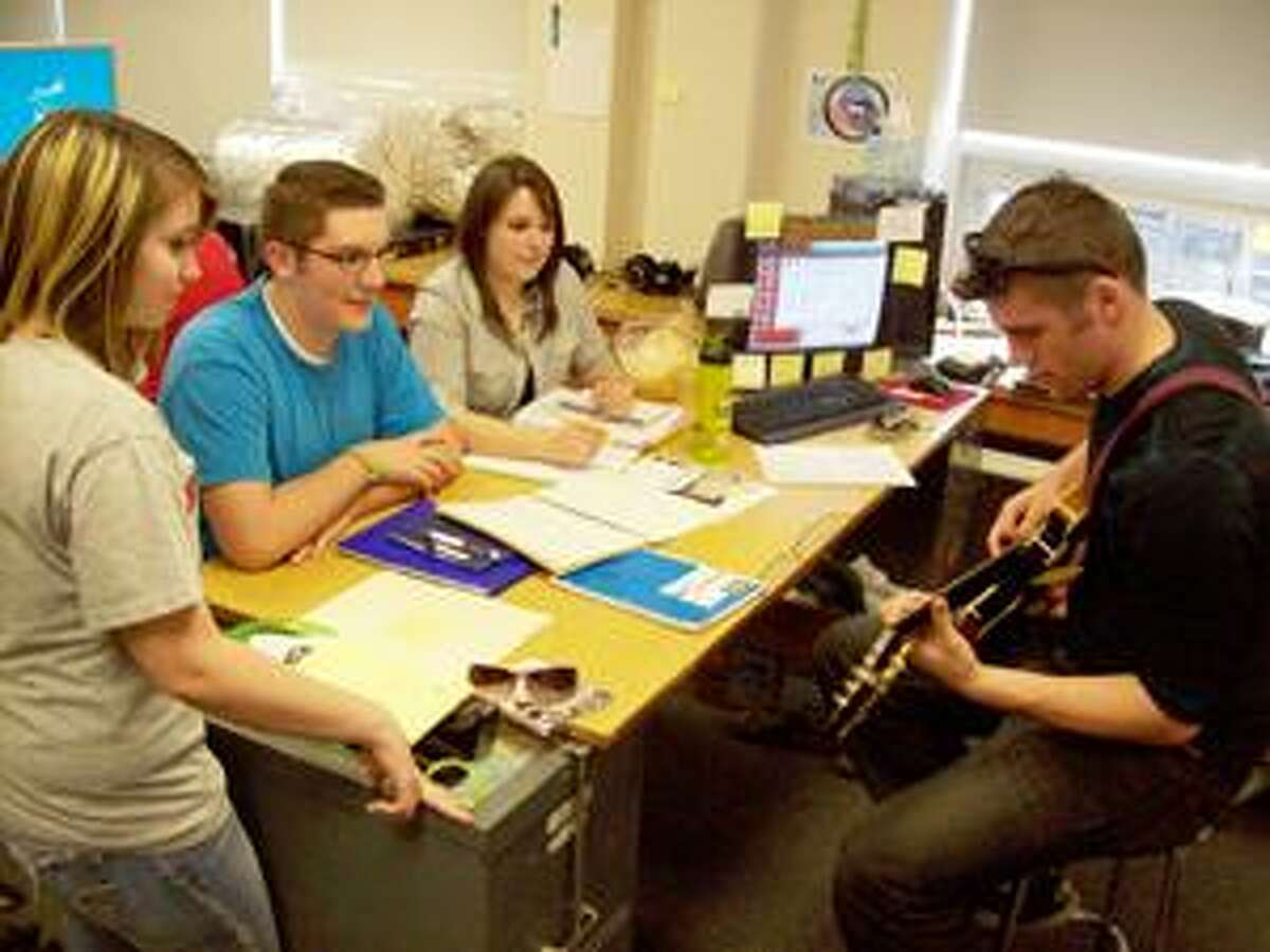 """Photo Special to the Dispatch by MIKE JAQUAYS Vernon-Verona-Sherrill Central School Entertainment Industry students, from left, Amber Bailey, 18, Adam Chandler, 17, Paige Brown, 17, and Nash Robb, 17, rehearse a song for the upcoming """"Hearts of Hope Vol. 1"""" CD of original music recorded for young cancer patients."""